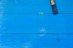 Painted blue wood. Acrylic paint, brush on wood Stock Photos