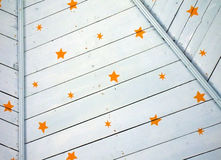 Painted Blue Wooden Ceiling with Stars Pattern Background. A detail of yellow stars painted on a light blue ceiling creates an interesting background Royalty Free Stock Image