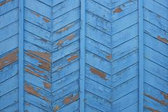 The painted boards at an angle. The peeled boards colored blue paint royalty free stock photo