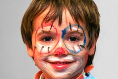 Painted boy face. Closeup face of a painted boy Royalty Free Stock Images