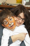 Painted boy and mother having fun Stock Images
