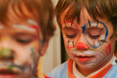 Painted boys. Boys with painted face, focus on lips Royalty Free Stock Photo