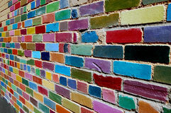 Painted Brick Wall. Colorful painted brick wall found in alley Royalty Free Stock Image