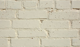 Painted brick wall. Brick wall painted in light yellow color royalty free stock photos