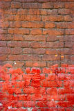 Painted brick wall half brown half red color. Good frame for text. Royalty Free Stock Photo