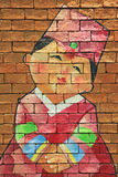 Painted Brick wall of Korean girl. With traditional hanbok dress korea Stock Image