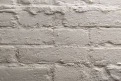 The painted brick wall. The brick wall painted by a white pastel Stock Photos
