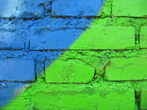 Painted bricks. Brick wall green and blue painted Stock Photography
