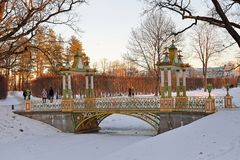 Painted the bridge with turrets through the Bypass channel in th. E Alexander Park in winter. Pushkin, Tsarskoye Selo, Saint Petersburg Royalty Free Stock Images