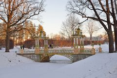 Painted the bridge with turrets through the Bypass channel in th. E Alexander Park in winter. Pushkin, Tsarskoye Selo, Saint Petersburg Royalty Free Stock Image