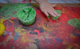 Painted in bright colors with baby hand or fingers. Painted in bright colors with hand or fingers for kids stock image