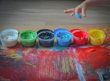 Painted in bright colors with baby hand or fingers. Painted in bright colors with hand or fingers for kids royalty free stock images