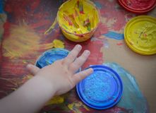 Painted in bright colors with baby hand or fingers. Painted in bright colors with hand or fingers for kids royalty free stock photos