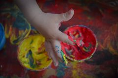 Painted in bright colors with baby hand or fingers. Painted in bright colors with hand or fingers for kids stock images
