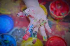 Painted in bright colors with baby hand or fingers stock photo
