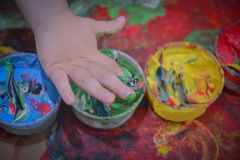 Painted in bright colors with baby hand or fingers. Painted in bright colors with hand or fingers for kids royalty free stock image