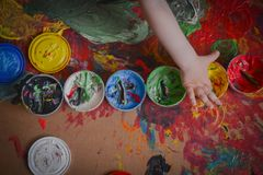 Painted in bright colors with baby hand or fingers stock photography