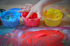 Painted in bright colors with baby hand or fingers. Painted in bright colors with hand or fingers for kids stock photography