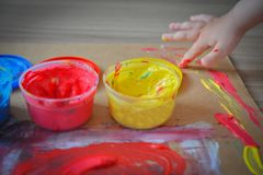 Painted in bright colors with baby hand or fingers. Painted in bright colors with hand or fingers for kids royalty free stock photo