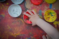 Painted in bright colors with baby hand or fingers stock photos