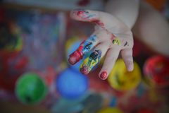 Painted in bright colors with baby hand or fingers. Painted in bright colors with hand or fingers for kids royalty free stock photography