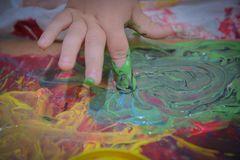 Painted in bright colors with baby hand or fingers royalty free stock photo