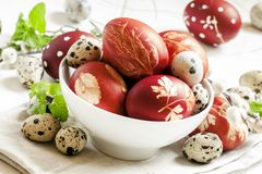 Painted brown Easter egg with a pattern, quail eggs, twigs of wi stock image