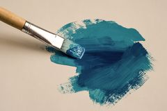 Painted brush strokes of blue color stock photo