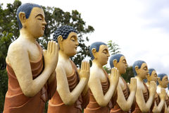 Painted Buddhist Monk statues Royalty Free Stock Images