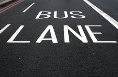Painted bus lane sign on road Stock Photo