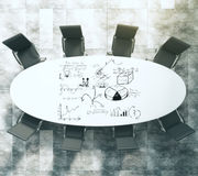 Painted business scheme on oval white conference table with blac Stock Photo
