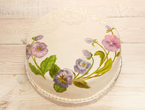 Painted cake fondant with food coloring. Cake with painted viola. Flowers royalty free stock photography