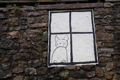 Painted cat in a window Stock Photography