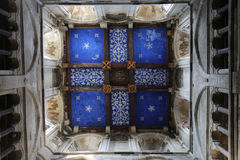 Painted Ceiling in a Medieval Church Tower. The painted ceiling in the medieval tower of Wimborne Minster. It has a vivid blue background with gold stars royalty free stock images
