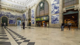 Painted ceramic tileworks on the walls of Main hall of Sao Bento Railway Station in Porto timelapse. Painted ceramic tileworks Azulejos on the walls of Main stock video