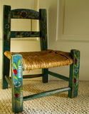 Painted Chair. An antique wood chair with hand painted stencils royalty free stock photography