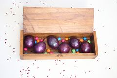 Happy Easter purple eggs in wooden box Stock Photography