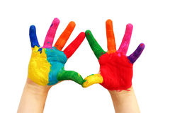 Painted child hands. Child hands painted in colorful paints ready for hand prints royalty free stock photo