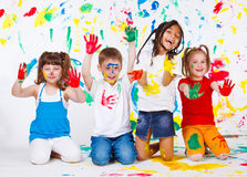 Painted children. Playful children painted all over Stock Image