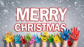 Painted children hands with smileys with `Merry christmas ` message royalty free stock photos