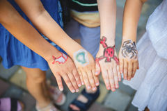 Painted children& x27;s hands in different colors with smilies. Painted children& x27;s hands in different colors with different smilies stock photo