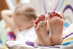 Painted childrens fingers feet Stock Image