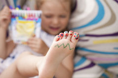 Painted childrens fingers feet. Body part, Painted childrens fingers feet royalty free stock photography