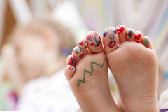 Painted childrens fingers feet Stock Photos