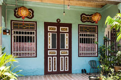 Painted Chinese townhouse. With decorative door and Chinese lanterns in historic George Town, Penang, Malaysia Stock Photo