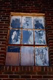 Painted and Chippy Windows in Brick Building stock images