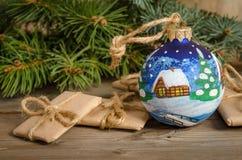 painted Christmas ball and correspondence Royalty Free Stock Image