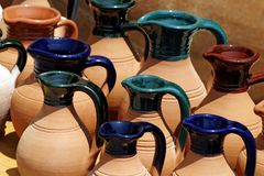 Painted Clay Jugs. Cypriot Greek clay pots on display Stock Photography