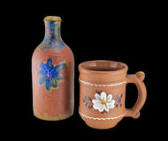 Painted clay mug and bottle Stock Image