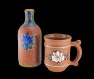 Painted clay mug and bottle Stock Image